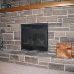 brown limestone ledgerock fireplace