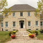 harvest gold limestone tumbled squared & ledgerock house front view