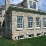 harvest gold limestone tumbled squared & ledgerock house side windows