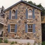 random split filedstone house wall
