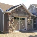 split fieldstone squared garage and house