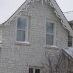 white to grey limestone house closeup