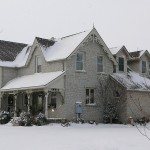 white to grey limestone house full view